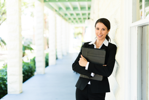 Real estate women smiling because she's getting more leads